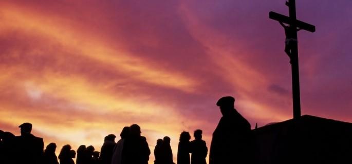 14413-people-look-cross-sunset-sunrise-yellow-orange-purple-clouds-jesus-easter.1200w.tn