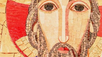Detail of the face, eyes of jesus Christ in a mosaic