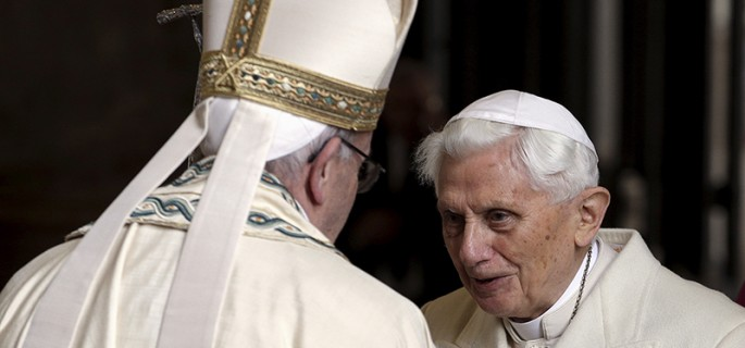 Pope Francis, left, meets Emeritus Pope Benedict XVI before open the Holy Door to mark opening of the Catholic Holy Year, or Jubilee, in St. Peter's Basilica, at the Vatican, on December 8, 2015. Photo courtesy of REUTERS/Max Rossi